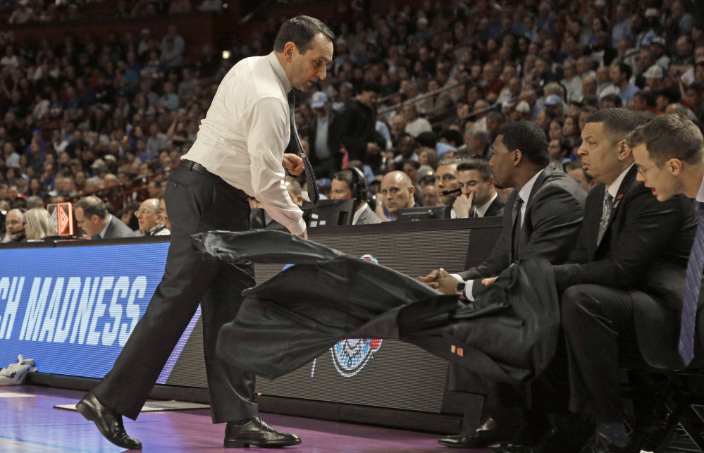 The jacket went flying in the first half and before the night was over, the entire season was out the window as Coach Mike Krzyzewski watched his Duke team, seeded second in the East, fall Sunday to South Carolina, 88-81.