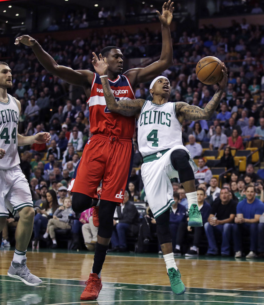Celtics guard Isaiah Thomas drives to the basket against Wizards center Ian Mahinmi in the first quarter of the Celtics' 110-102 win. Thomas finished with 25 points, after missing two games because of a bruised right knee.