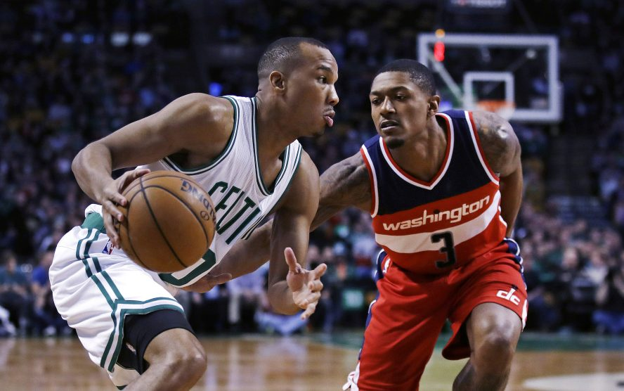 Celtics guard Avery Bradley sets to drive to the basket against Wizards guard Bradley Beal in the first quarter of Monday night's game in Boston.