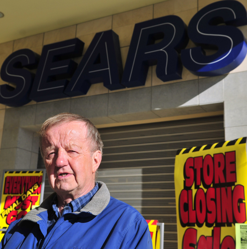 Former employee Cal Brown stands in front of the Sears in Augusta that will close this month, leaving regular Sears stores only in Bangor, Brunswick and South Portland.