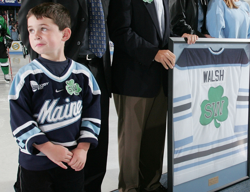 Sean Walsh was 5 years old during a 2004 ceremony at the University of Maine honoring his father's legacy. Now he will attend Canisius College before entering coaching.