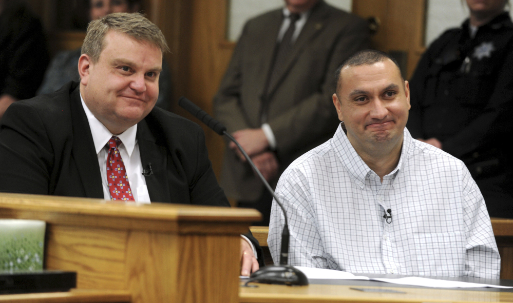 Christopher Tapp, right, and public defender John Thomas smile during Tapp's post conviction relief hearing at Bonneville Courthouse in Idaho Falls, Idaho, Wednesday.
