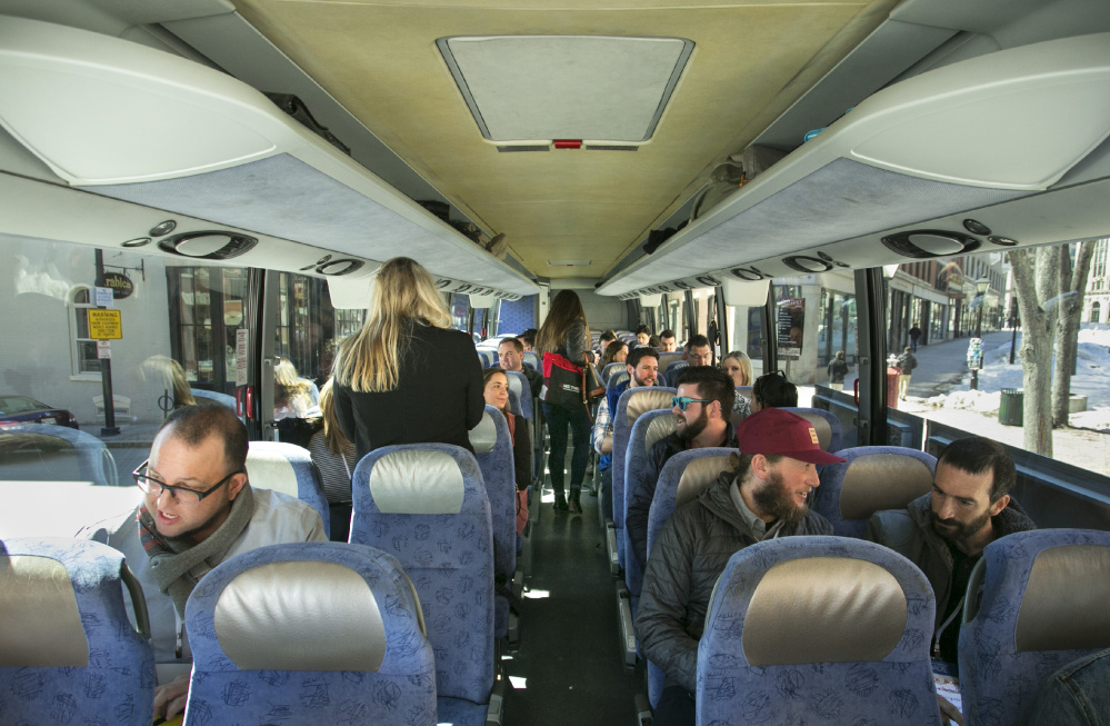 Recruiters from Maine companies board a bus in Portland and head to Boston to search for new hires on Thursday. They planned to promote Maine's quality of life as a recruiting advantage and met with workers over beer and food sourced in Maine.