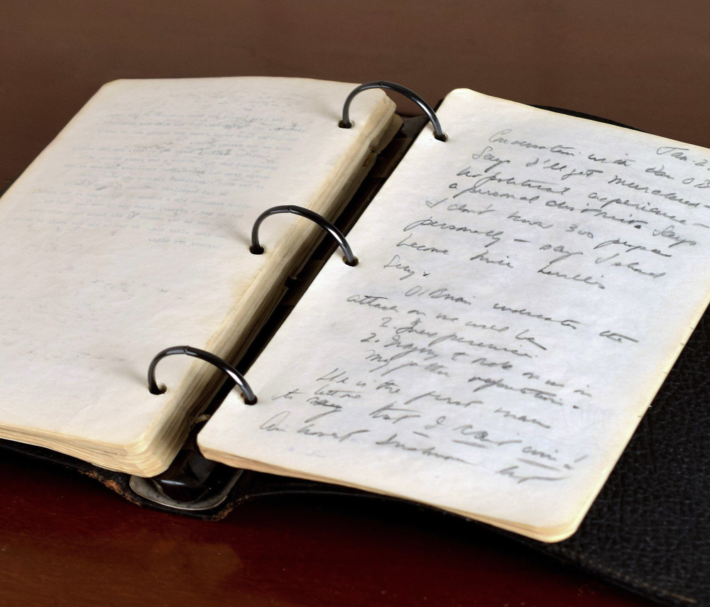 Photo released Thursday by RR Auction shows a portion of a diary written in 1945 by a young John F. Kennedy during his brief stint as a journalist after World War II.
