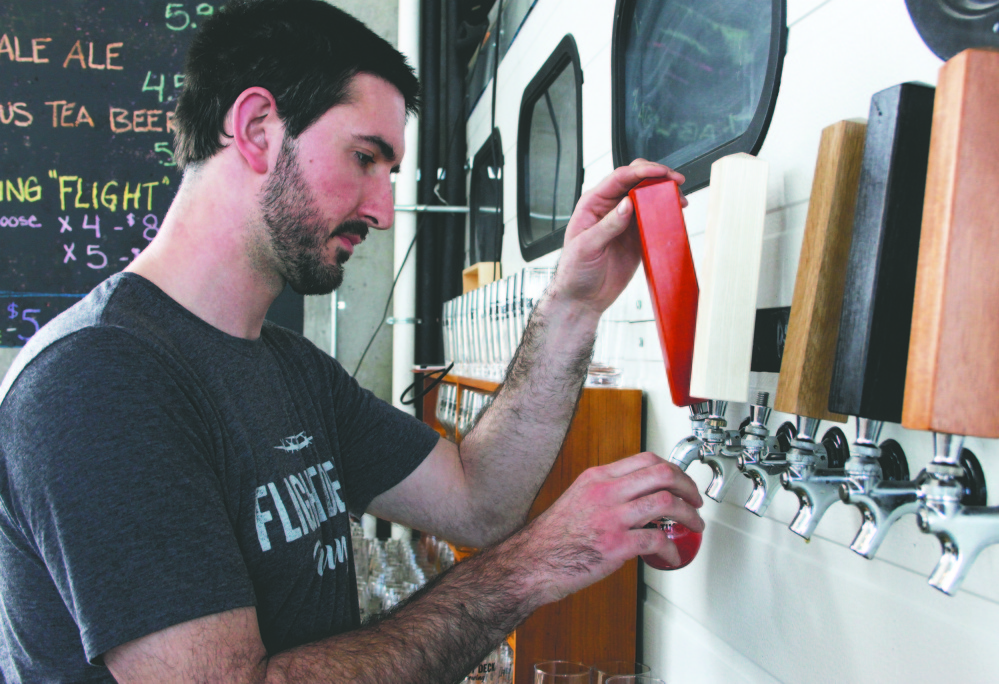 Jared Entwistle, one of the two co-owners, is the man behind the beer for the new Flight Deck Brewing at Brunswick Landing. The brewery held its grand opening on March 16.