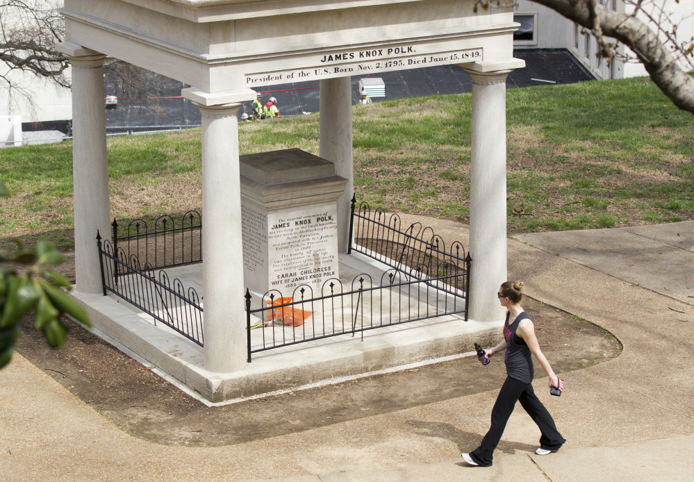 A visitor looks at the burial place of President James K. Polk and his wife, Sarah, on the grounds of the state Capitol in Nashville, Tenn. A resolution being considered in the state Legislature calls for exhuming their bodies and moving them to the James K. Polk Home and Museum in Columbia, Tenn.