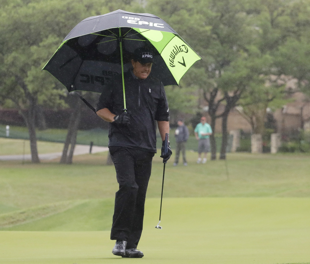 Phil Mickelson walks off the fifth green during a rainy round-robin portion of the Dell Technologies Match Play tournament Friday at Austin, Texas.