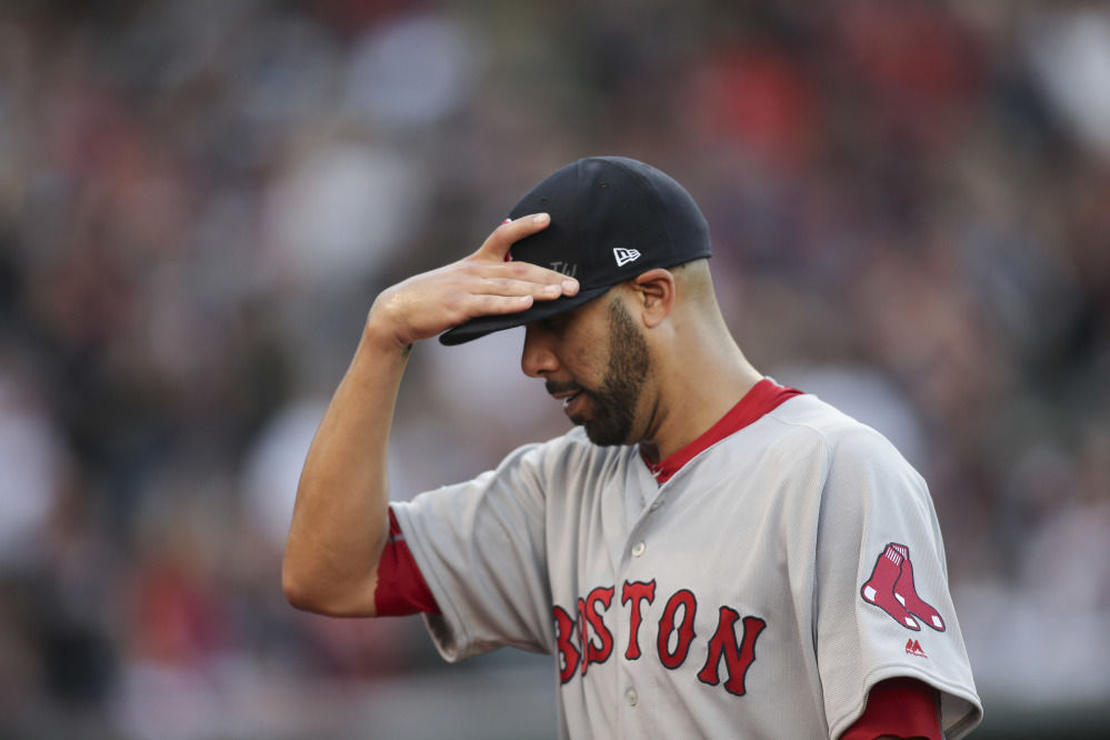 Boston Red Sox pitcher David Price walks off the field after being removed during the fourth inning against the Indians in Game 2 of an American League Division Series, on Oct. 7 in Cleveland.