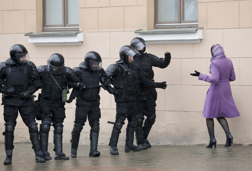 A woman tries to argue as  club-wielding Belarus police block a street during an opposition rally in the capital of Minsk on Saturday.