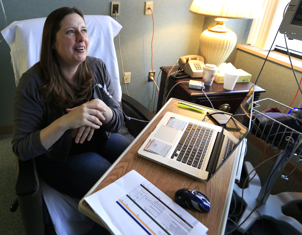 Janella Williams, 45, monitors action on the Obamacare replacement bill Friday as she watches news reports while receiving treatment for a neurological disorder at Lawrence (Kan.) Memorial Hospital.