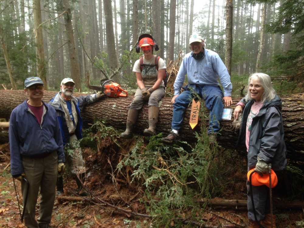 A volunteer crew for the Coastal Mountains Land Trust participates in field work at Fernalds Neck. The trust is now accepting registrations for two new volunteer training sessions it will offer in April.
