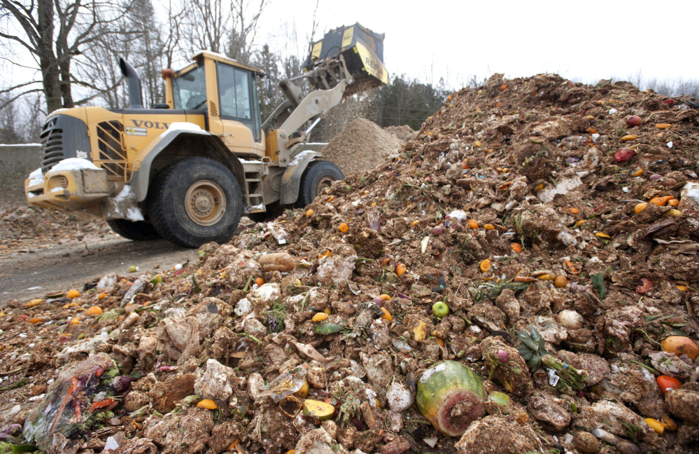 An attachment on an excavator grinds up food waste at Agri-Cycle Energy in Exeter, a sister company of Exeter-Agra Energy. Food waste collected in South Portland and Scarborough will go to ecomaine in Portland and then be shipped to Exeter-Agra.