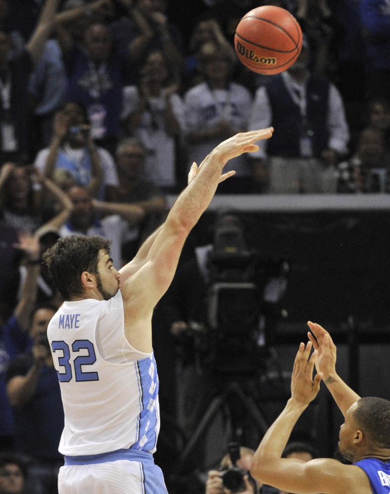 Luke Maye lofts the ball toward the basket Sunday, hitting the shot that put North Carolina into the Final Four by beating Kentucky.