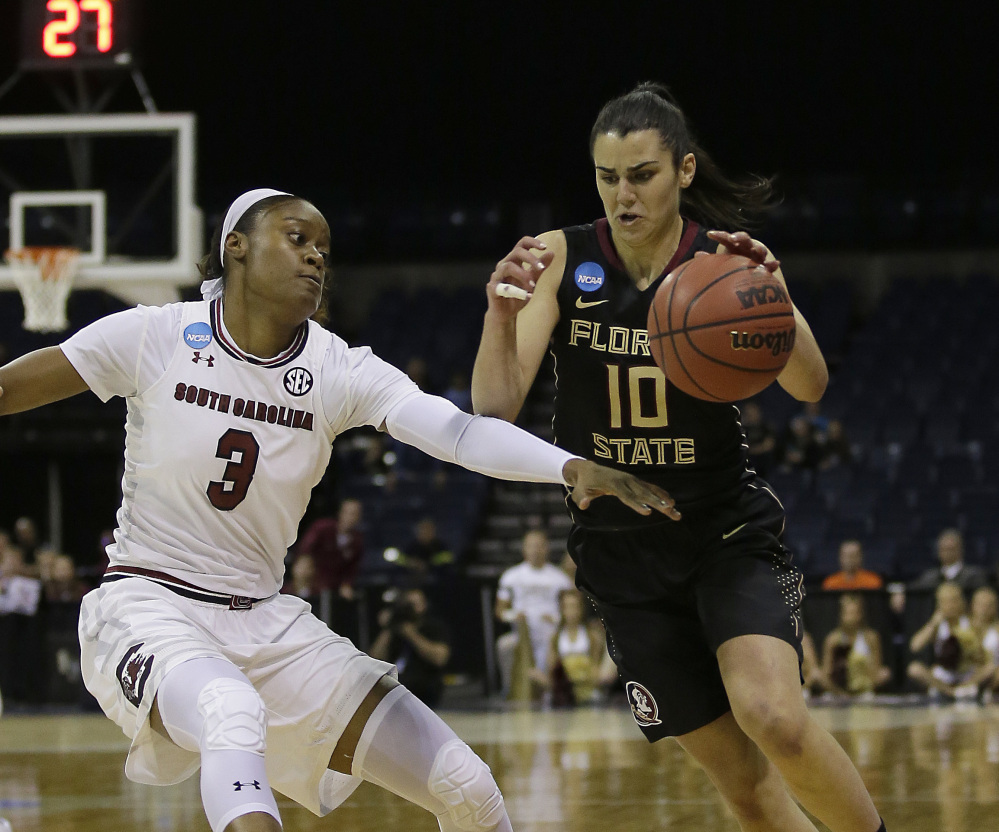 Florida State guard Leticia Romero, right, drives against South Carolina guard Kaela Davis during the first half of the Gamecocks' 71-64 win in a regional final Monday in Stockton, California.