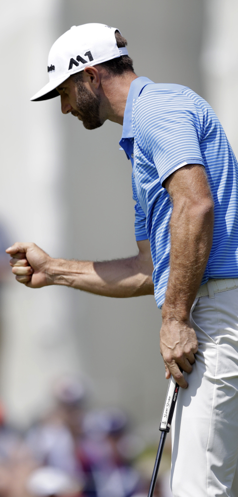 Dustin Johnson celebrates after making a putt on the 18th hole to win his match over Hideto Tanihara in the semifinals of the Dell Technologies Match Play in Austin, Texas, on Sunday.