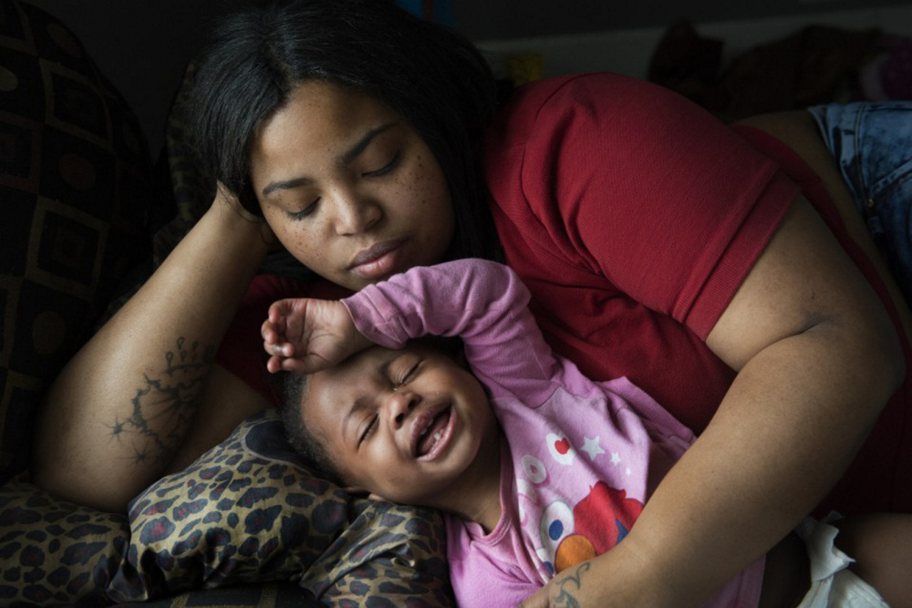 Nakeyja Cade with her year-old daughter Zariyah Cade in Flint, Mich., last March. The girl's blood had tested high for lead. A new study shows children with elevated blood-lead levels at age 11 ended up as adults with lower cognitive function than their parents.