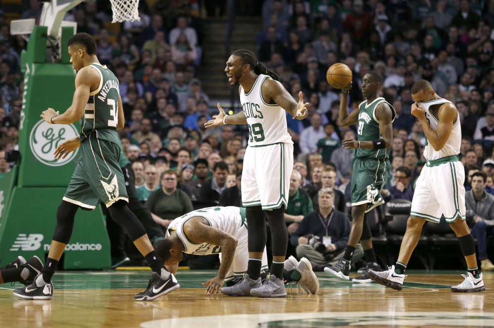 Boston's Jae Crowder reacts to a call during the first half of Wednesday's game against the Milwaukee Bucks at Boston.