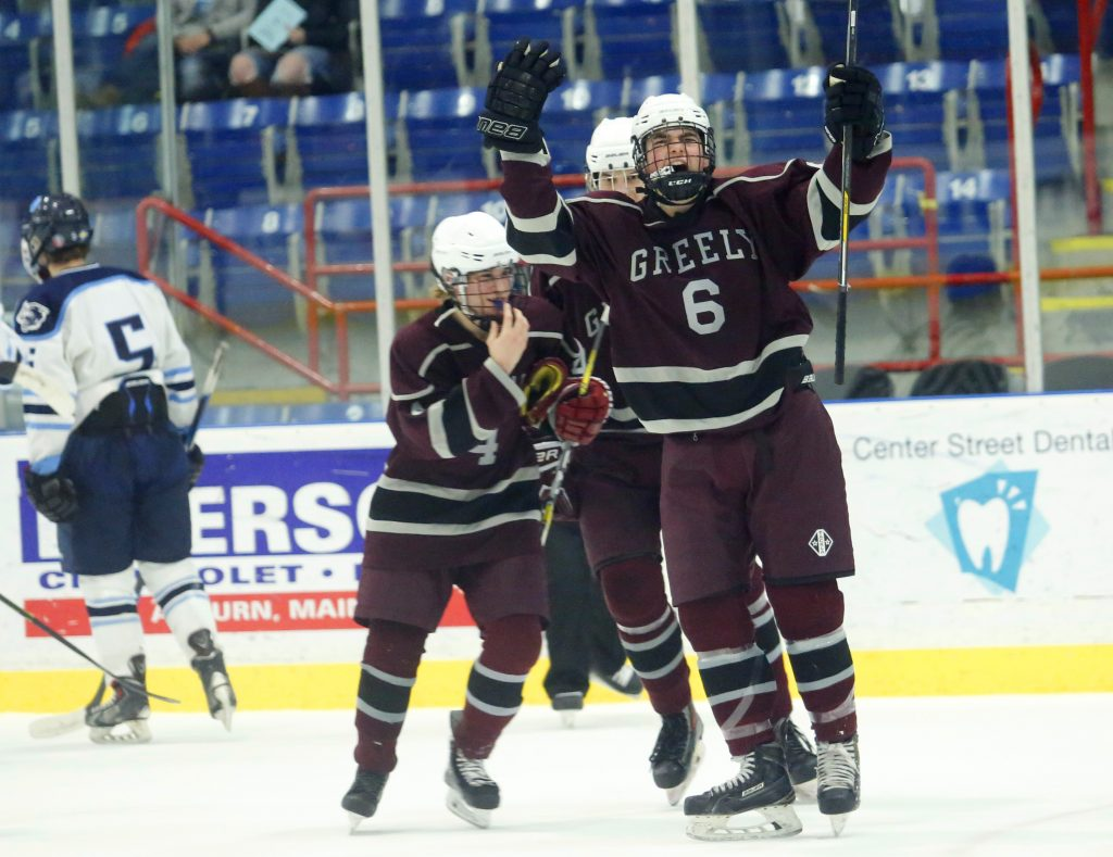 Ben Kennedy of Greely celebrates after teammate Matthew Kramlich scored on a power play in the first period. (Derek Davis/Staff Photographer)