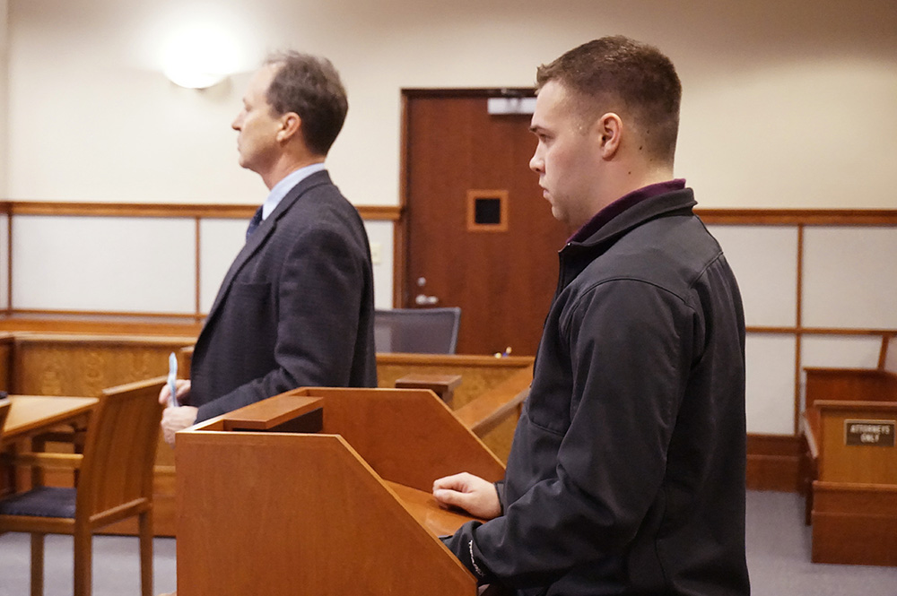Nicholas Perry makes his initial appearance with his attorney at Cumberland County Courthouse on Wednesday on a charge of inappropriate contact with a Bonny Eagle High School student while he was cheering coach at the school. Perry entered no plea and his $5,000 bail, which he posted at the time of his arrest in January, was continued.