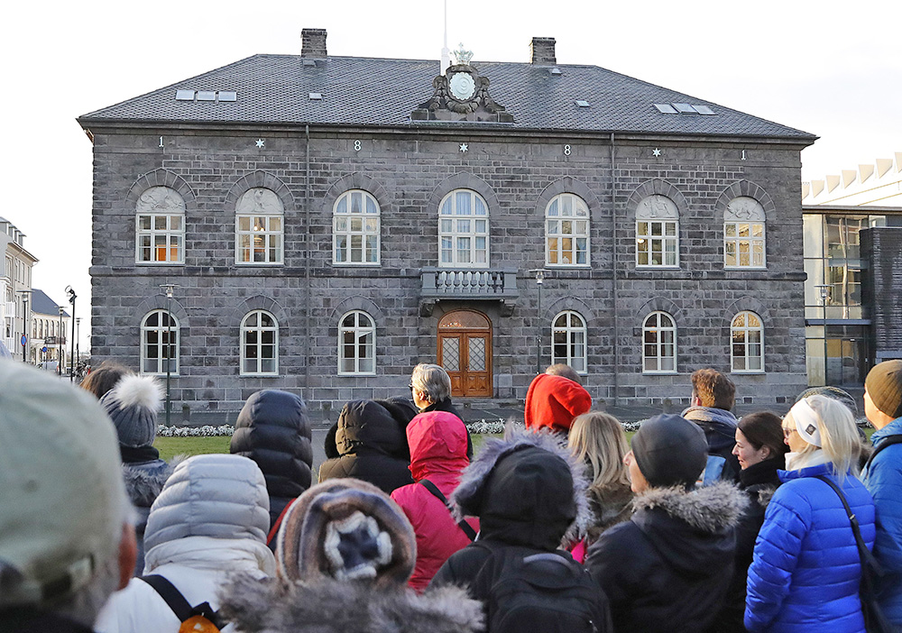 A crowd forms in front of the Icelandic parliament, the Althing, in Reykjavik last October, when thousands of Icelandic women left work at 2:38 p.m. and demonstrated outside parliament to protest the gender pay gap.
