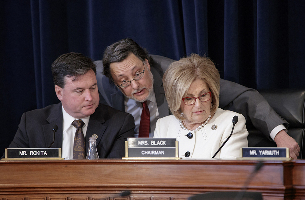 House Budget Committee Chair Diane Black, R-Tenn., right, joined at left by Rep. Todd Rokita, R-Ind., and panel staff member Jim Bates, works on the Republican health care bill, on Capitol Hill  Thursday.