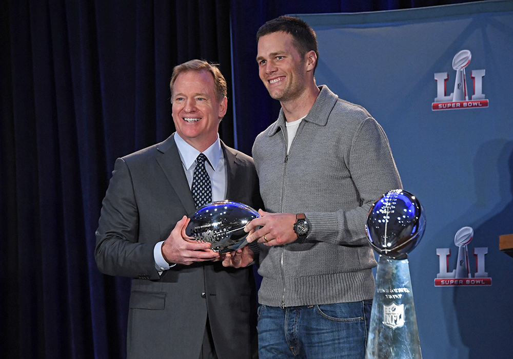 NFL commissioner Roger Goodell presents Patriots quarterback Tom Brady with the Pete Rozelle Trophy as Super Bowl LI's most valuable player on Feb 6, 2017, in Houston.