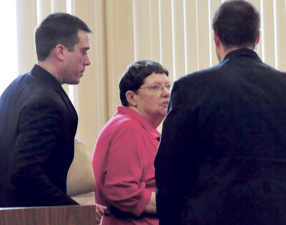 Mary O'Donal and her attorney Christopher Berryment, left, speak with a court officer after O'Donal was sentenced Thursday in Franklin County Superior Court to three years in prison, with all but 30 days suspended, and ordered to pay restitution for stealing more than $300,000 from the Share and Care Food Closet in Farmington.
