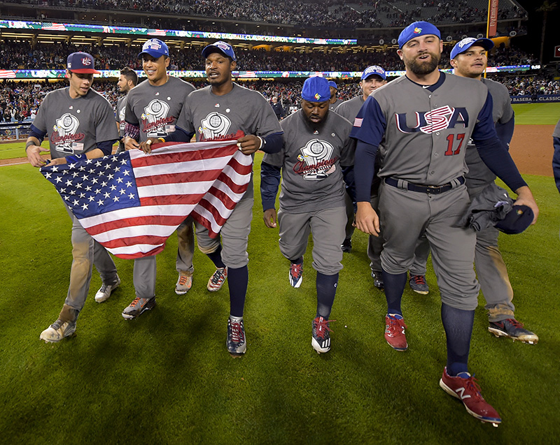The U.S team celebrates an 8-0 win over Puerto Rico in the final of the World Baseball Classic in Los Angeles.