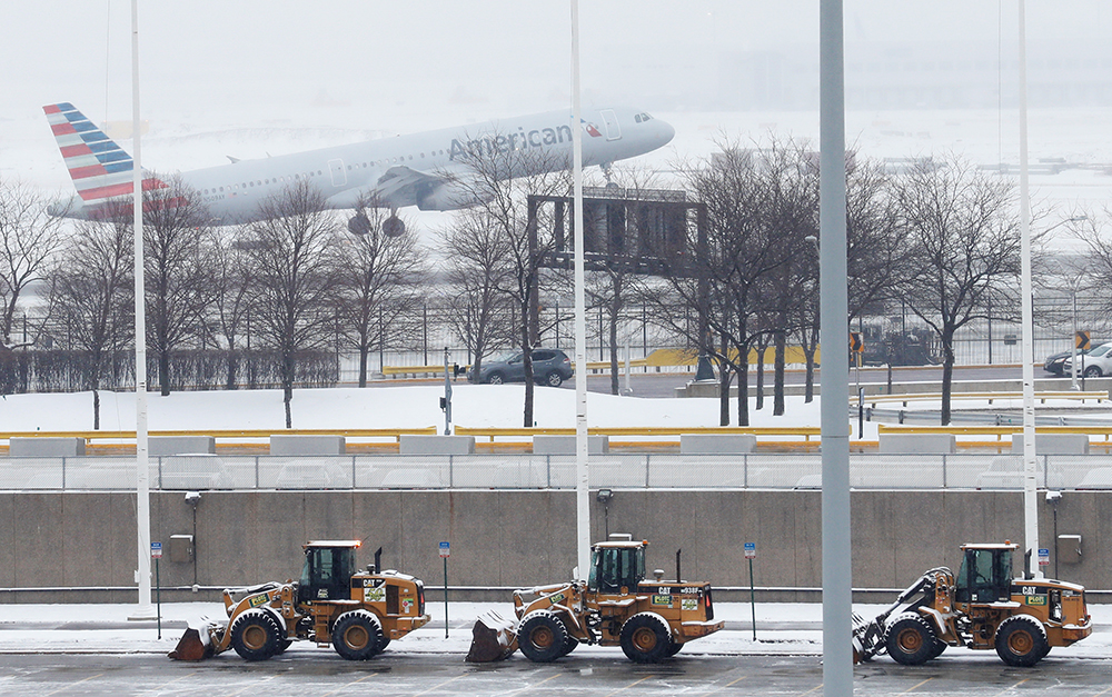 An American Airlines jet departs during the snowstorm at O'Hare International Airport in Chicago on Monday. Some areas received up to 5 inches of snow, and more than 400 flights were canceled at O'Hare.