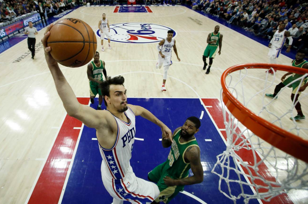 Philadelphia's' Dario Saric goes up for a shot against Boston's Amir Johnson during the second half of Sunday in Philadelphia. Philadelphia won 115-99.