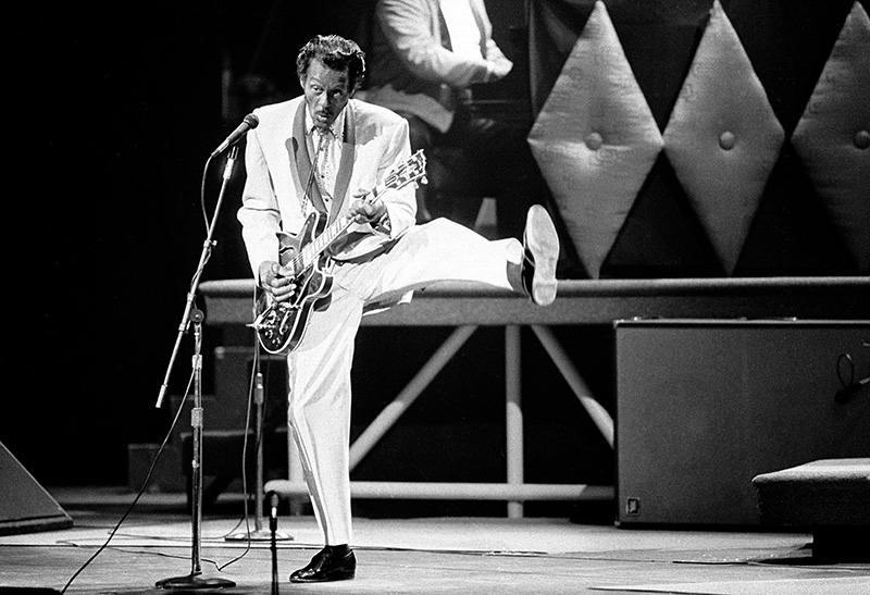 Chuck Berry performs during a concert celebration for his 60th birthday at the Fox Theatre in St. Louis, Mo., in 1986.