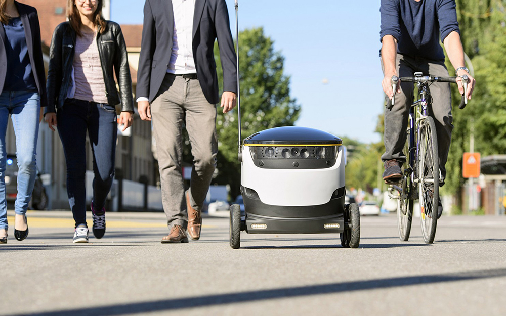 A robot travels among humans in Bern, Switzerland. A robotics company from Estonia has been testing its robot couriers, about the size of an Igloo cooler,  in the District of Columbia for the past few weeks.