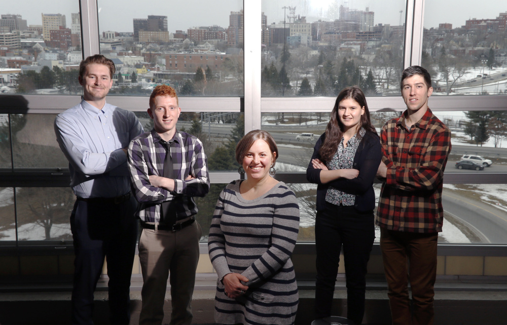 Lora Winslow, center, directs Manomet's U360 program, which offers internships to college students interested in sustainability in small businesses. With her, from left, are Bobby Jordan, Caleb Pulliam, Leah Soloway and Karol Olszynski.