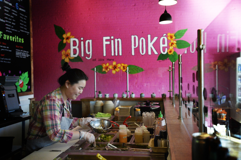 Samantha Liang prepares a poké bowl at Big Fin Poke in Westbrook.