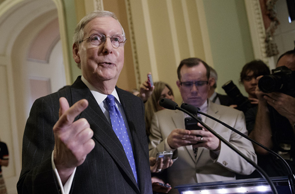 Senate Majority Leader Mitch McConnell, R-Ky., speaks to reporters Tuesday about the Republican plan to enact a unilateral rules change to eliminate the filibuster for Supreme Court nominees.