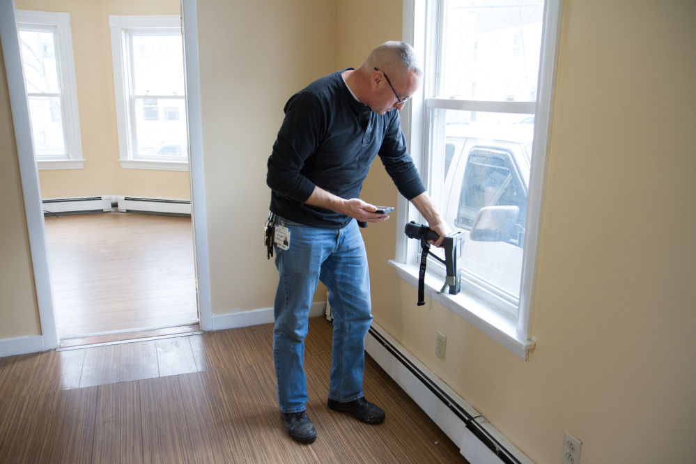 Robert Martel of Community Concepts Housing and Energy Services conducts a lead inspection at an apartment on Howe Street in Lewiston. Kids in Lewiston-Auburn get lead poisoning at three times the rate of the rest of the state.