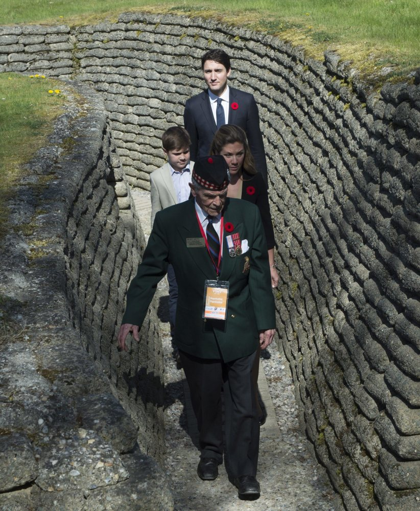 Richard Read, whose father fought at Vimy, guides Canadian Prime Minister Justin Trudeau, Sophie Gregoire Trudeau and their son Xavier near Arras, France, Sunday.