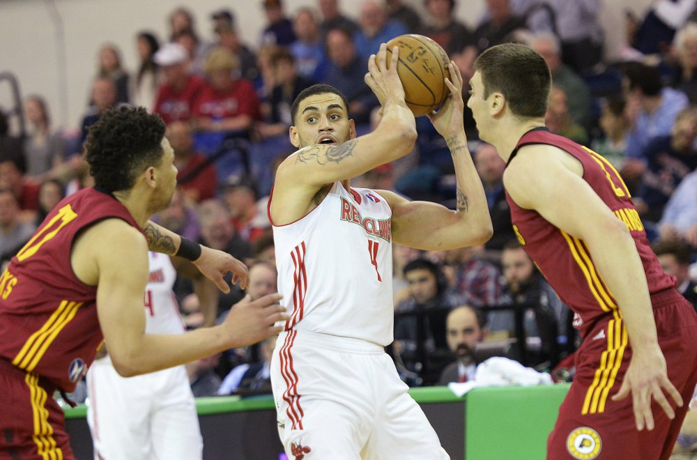 Abdel Nader and his Maine Red Claws teammates will look for a way to get past Stephan Hicks, left, Tyler Hansbrough and the rest of the Fort Wayne Mad Ants in Game 3.