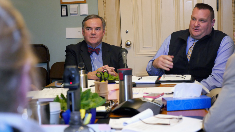 Vermont's Department of Motor Vehicles Commissioner Robert Ide, left, and DMV enforcement director William Elovirta testify before the state's Senate Government Operations Committee in Montpelier, Vt., on Tuesday.