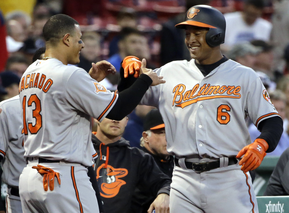 Baltimore's Jonathan Schoop, 6, celebrates his solo home run with Manny Machado in the first inning Wednesday night at Fenway Park.
