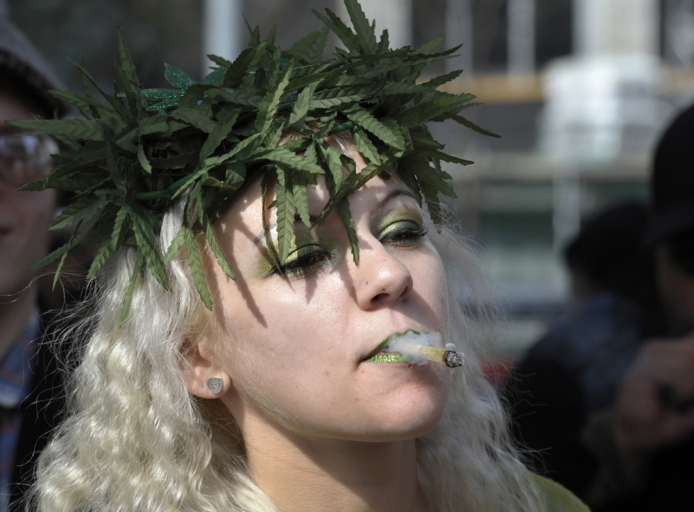 A woman smokes marijuana during a rally to protest for the legalization of marijuana in Toronto in 2012. Marijuana enthusiasts across Canada gather by the thousands every year on April 20 for an international celebration-cum-protest for marijuana legalization.