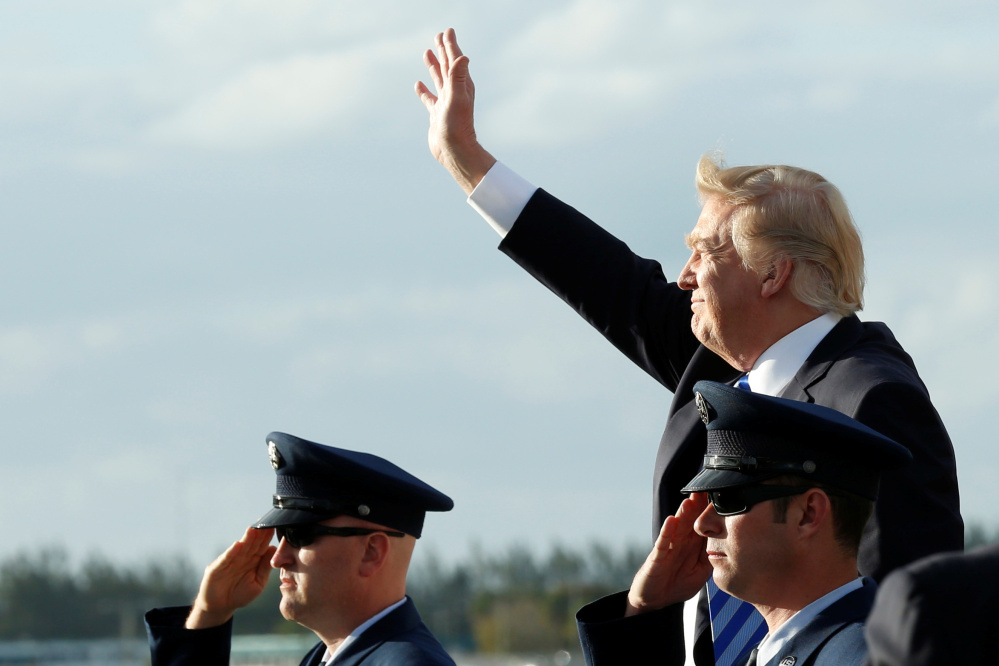 President Trump arrives to board Air Force One on Thursday at Joint Base Andrews outside Washington, D.C., before traveling to Palm Beach, Fla., for the Easter weekend.