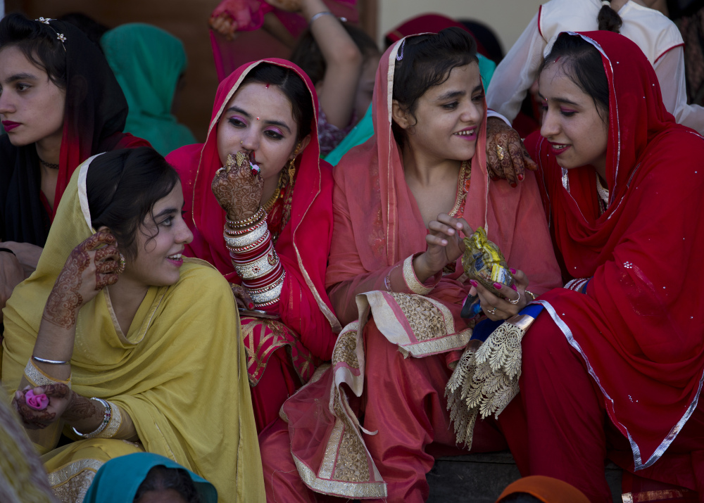 Girls from a Sikh community attend a festival in Hasan Abdal near Islamabad, Pakistan, on Friday. The pilgrims arrived from neighboring India to a shrine of Gurdwara Punja Sahib. The religion was founded in India to promote religious freedom, gender equality and opportunity for all.