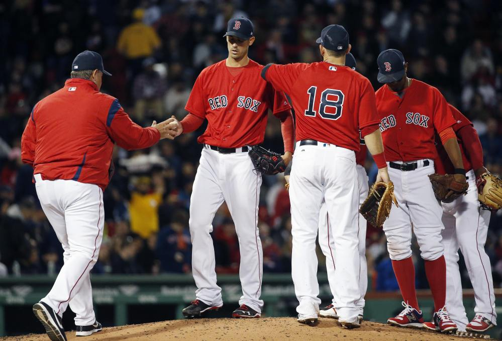 Boston's Rick Porcello, seen coming out of a game in April, is the defending Cy Young Award winner but has given up more runs than any pitcher in the American League this season. Despite that and other pitching problems, the Red Sox found themselves tied for the division lead Monday.