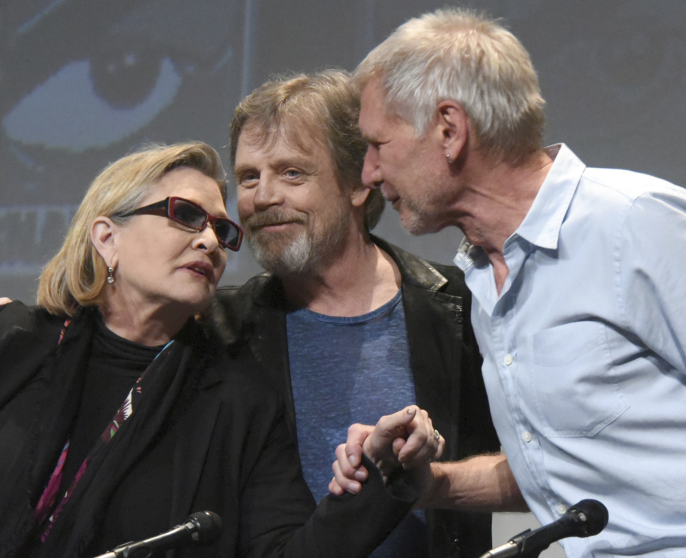 Carrie Fisher, Mark Hamill and Harrison Ford attend Comic-Con International in San Diego in 2015.