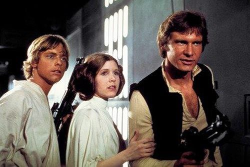 Photo provided by Twentieth Century Fox Home Entertainment shows, from left, Mark Hamill as Luke Skywalker, Carrie Fisher as Princess Leia Organa, and Harrison Ford as Han Solo in the original 1977