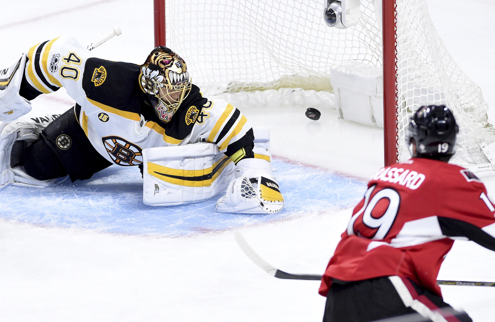 Ottawa center Derick Brassard scores on Boston goalie Tuukka Rask during third period of Saturday's playoff game in Ottawa. Ottawa scored two goals in the third period, then again in overtime to beat the Bruins 4-3 and tie their playoff series 1-1. (Sean Kilpatrick/The Canadian Press)