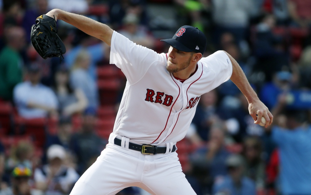 Chris Sale delivers a pitch for the Red Sox against Tampa Bay in Boston on Saturday. Sale earned his first win with the Red Sox, striking out 12 and walking three with just one earned run over seven innings. (Associated Press/Michael Dwyer)