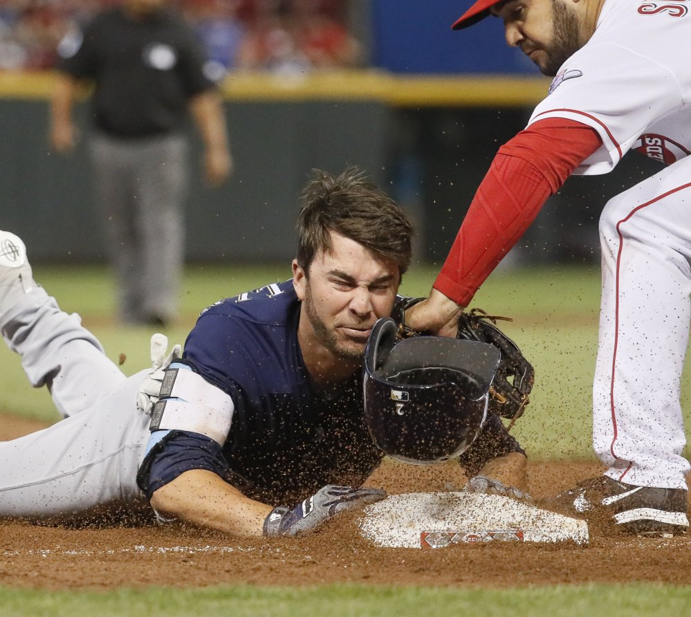 Nick Franklin of the Milwaukee Brewers slides safely into third base with a two-run triple Saturday, but the Cincinnati Reds came away with a 7-5 victory.