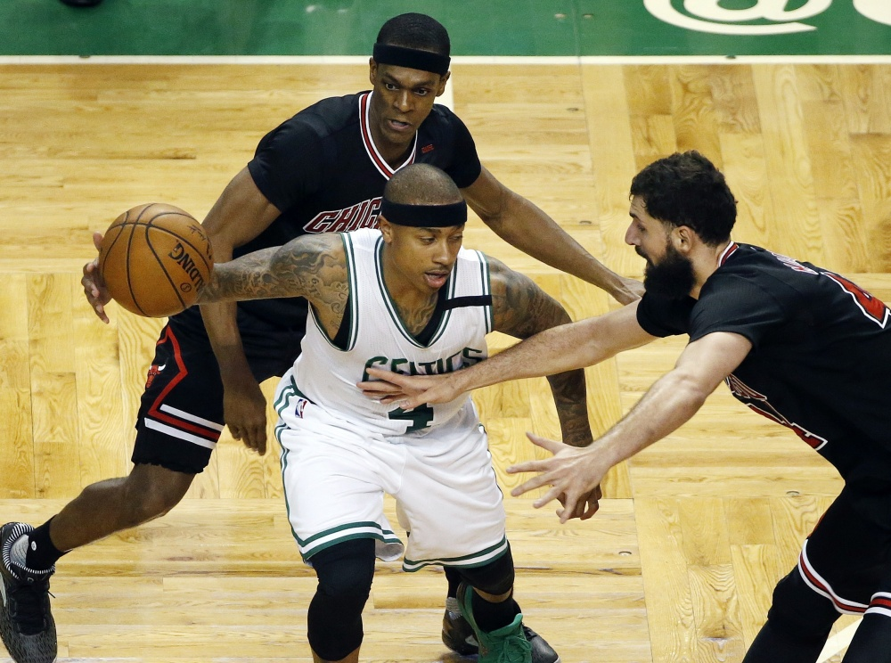 Chicago's Rajon Rondo, back, and Nikola Mirotic, right, defend Boston's Isaiah Thomas during the third quarter of the Celtics' 106-102 loss in Game 1 of their Eastern Conference first-round playoff series Sunday in Boston.